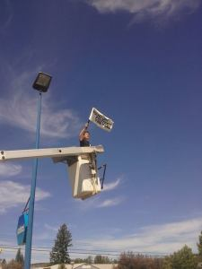 Flag-in-a-bucket-lift-in-Cache-Creek
